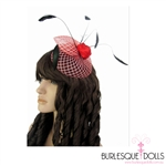 Gorgeous red and white criss-cross mesh fascinator, featuring a red satin rose centre piece and black feather detailing. The fascinator also features two metal clips for easy placement.